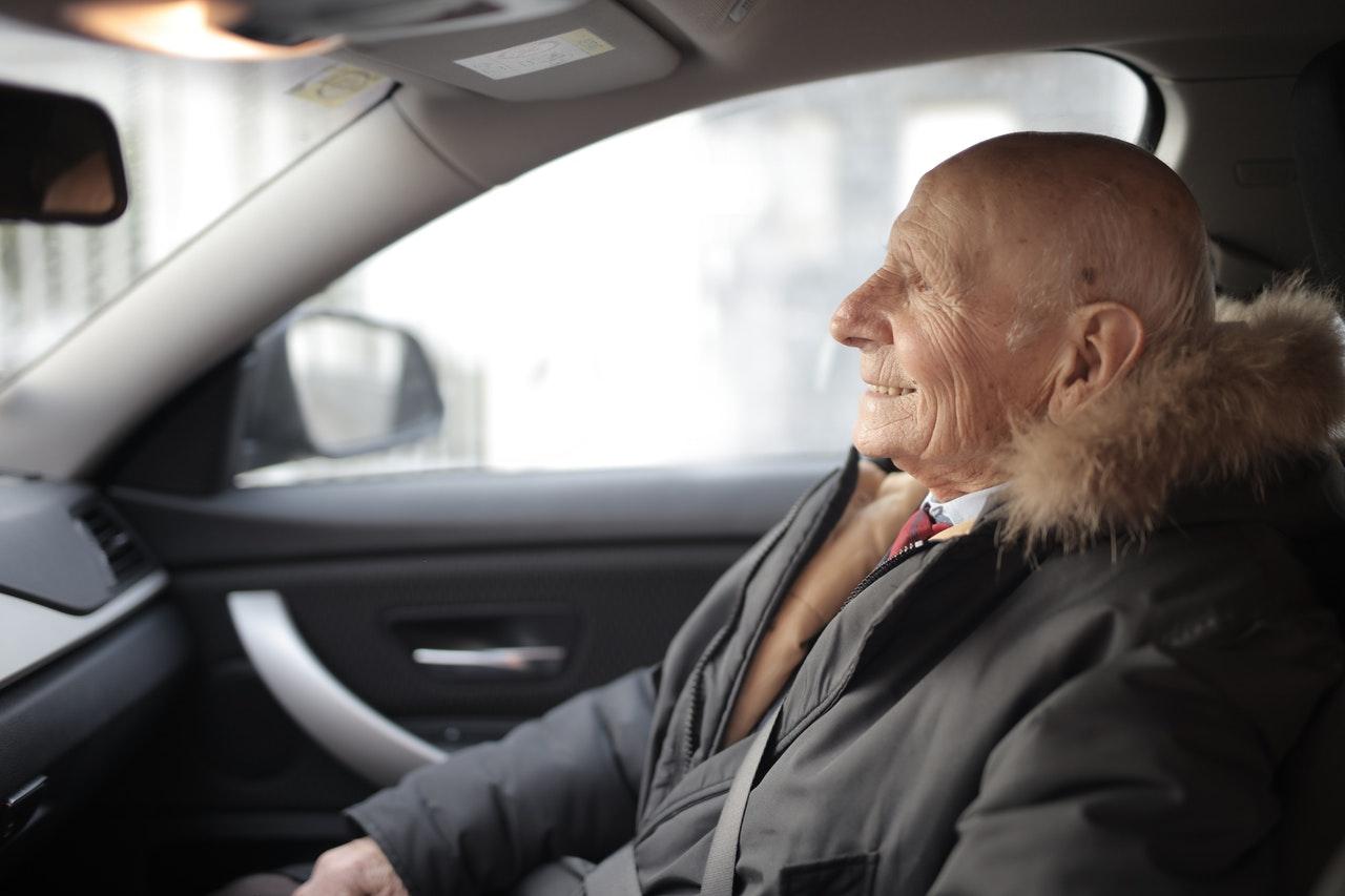 Man Smiling in Car